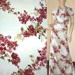 Атлас стрейч шамус молочний з бордово-коричневими квітами ш.150