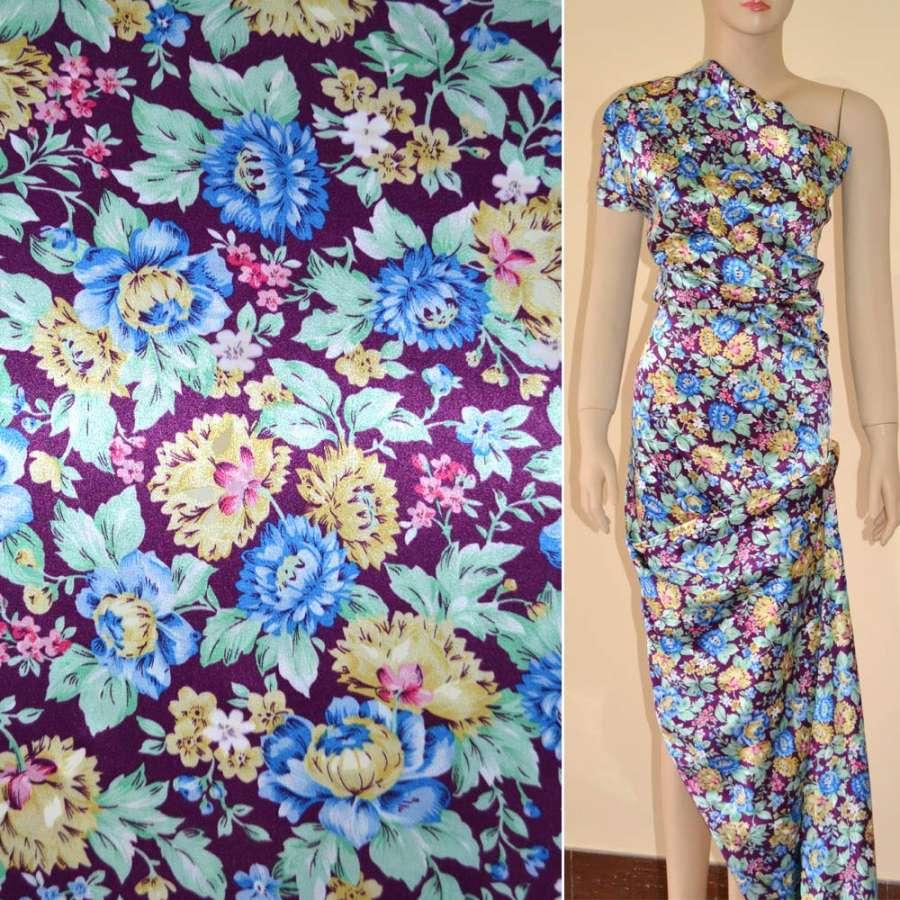 Стрейч атлас темно сиреневый с голубыми цветами ш.150