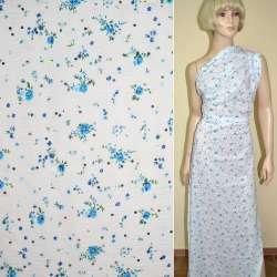 Батист белый с голубыми цветами, блестками и жаткой ш.140