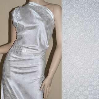 ткань жаккард. белая с тиснеными кругами ш.145 см.