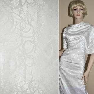 ткань жаккард. белая с надписями ш.150 см.