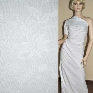 ткань жаккард. белая в мелкие ромашки ш.150 см.