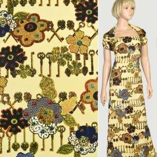Рогожка стільники жовта в коричневі ключі і сині квіти, ш.150