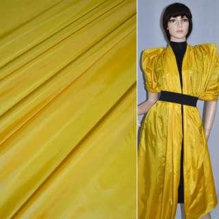 Ткань плащевая блестящ. желтая ш.150