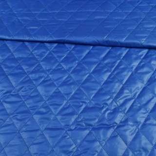 Тканина плащова стеганая синя ромби ш.150