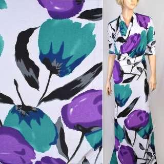 Трикотаж белый с фиолетовыми,бирюзовыми,черными цветами ш.160