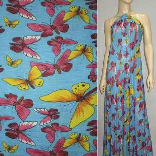 Трикотаж жатий блакитний з метеликами ш.150