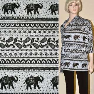 Трикотаж сірий з чорними слонами і огірками ш.170