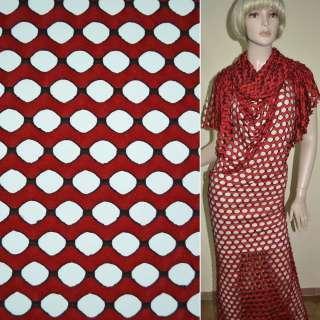 Трикотаж червоний хвилі з овальними дірочками ш.160