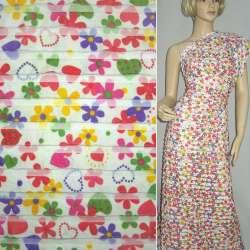 Трикотаж белый с рюшами и цветными цветами ш.150