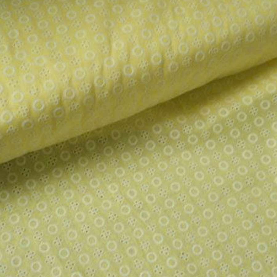 Шитье желтое светлое в круги и белые цветы с дырками ш.145