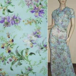 Шифон Діллон блакитний з фіолетово-зеленими квітами ш.150