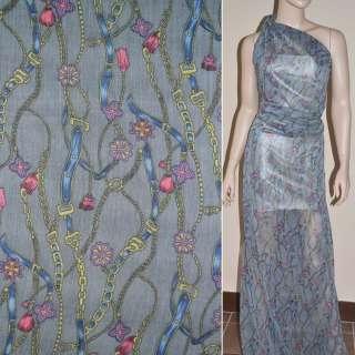 Шифон жатий сірий з синьо-жовтими поясами ланцюгами квітами ш.150