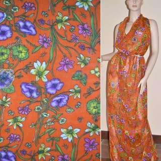 Шифон жатий оранжево-червоний з фіолетово-зеленими квітами і метеликами