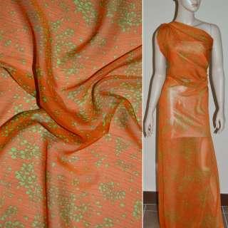 Шифон жатий помаранчевий з дрібними зеленими квітами ш.140