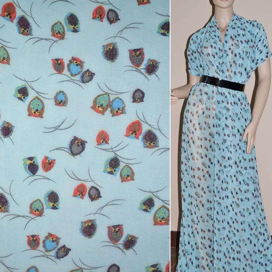 Шифон бледно-голубой с разноцветными совами ш.150