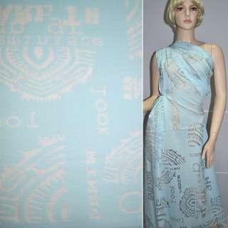 Віскоза деворе блакитна з абстрактним малюнком і написами ш.134 см