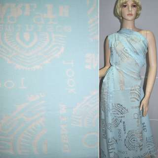 вискоза голубая с абстр.рис.деваре и надпис.шир.134 см