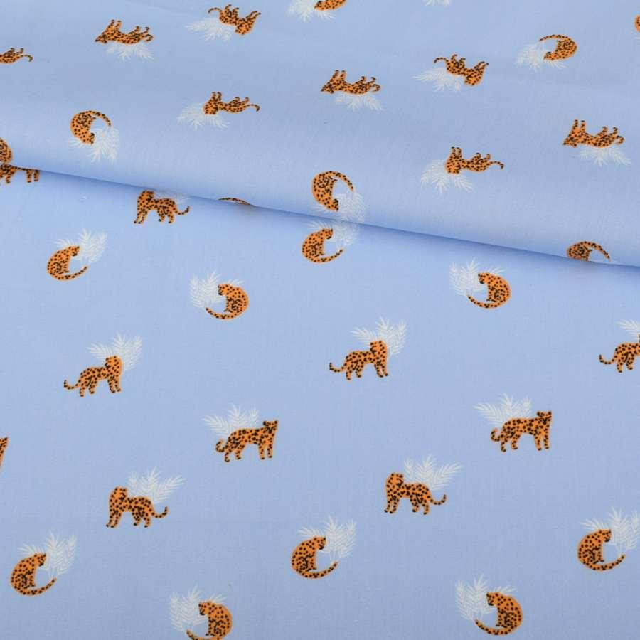 Коттон голубой, оранжевые леопарды, белые веточки, ш.145