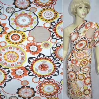 Трикотаж белый с оранжево-черно-желтыми цветами и подсолнухами ш.140