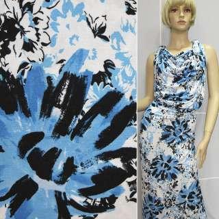 Трикотаж білий з чорно-блакитними квітами ш.140