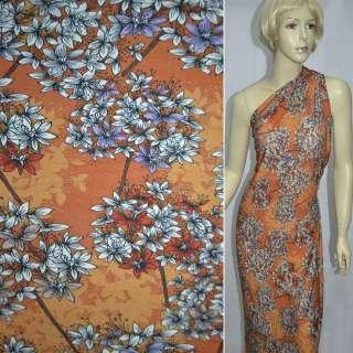 Трикотаж помаранчевий з фіолетово-білими букетами квітів ш.140