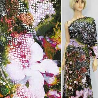 Трикотаж чорно-зелений з бузковими квітами і камінчиками ш.150