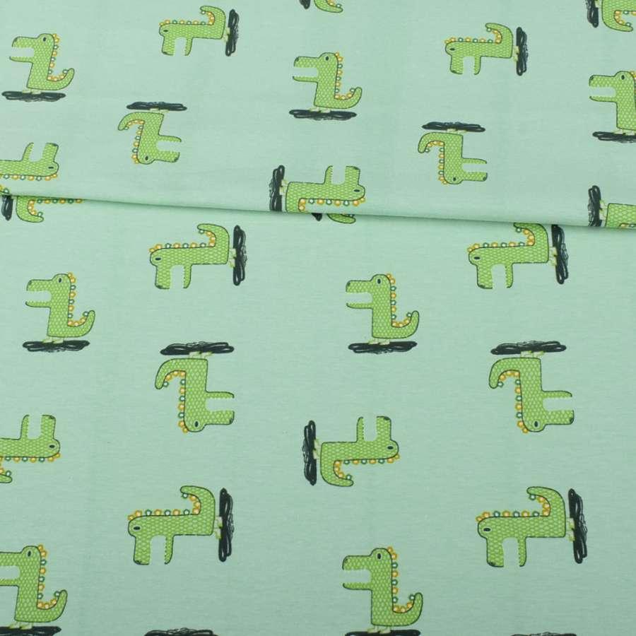 Трикотаж бавовна зелений світлий, зелені динозаврики, ш.151