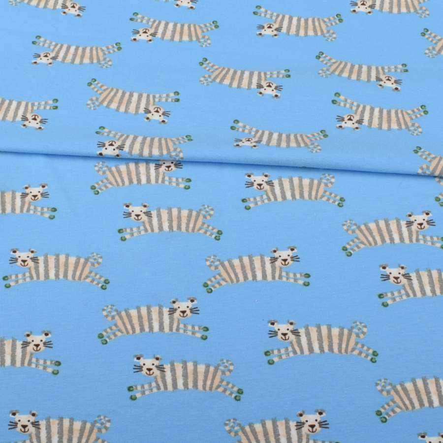 Трикотаж бавовна блакитний, смугасті тигри, ш.152