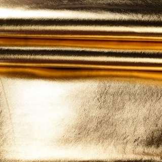 кожа искусств. золотистая блестящая, ш.140
