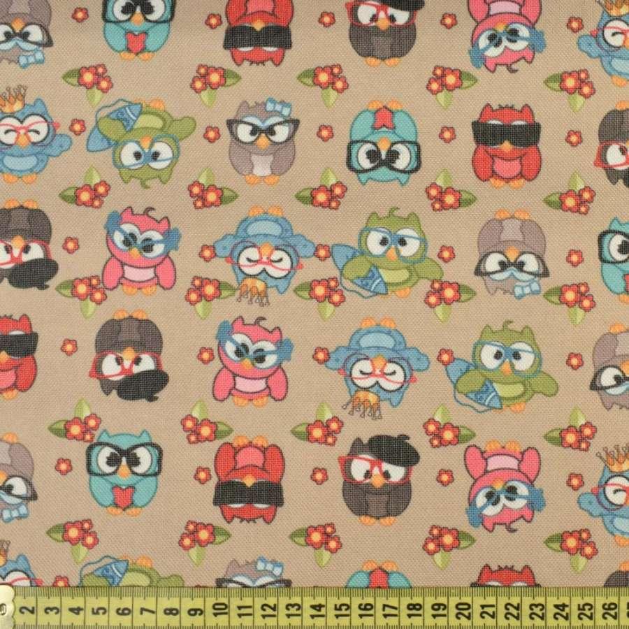 ПВХ ткань оксфорд 600 D бежевая в разноцветные совы, ш.150