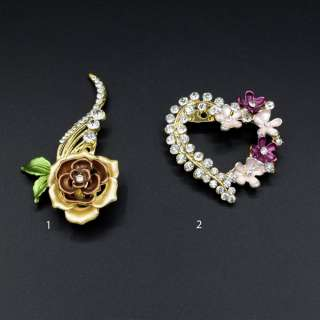 Брошка метал зі стразами квітка і серце золотиста