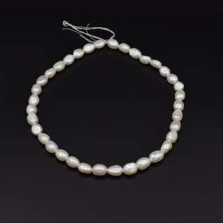 Намисто з натуральних річкових перлів овальні довжина 40см без замка білі