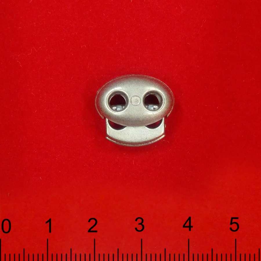 Фиксатор пластик 2 отверстия овальный